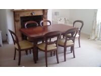 A quality Mahogany Reproduction Sheraton dining table and 6 chairs.