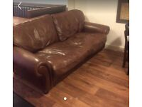 Large brown leather sofa. Must sell today