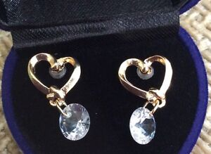 New heart shaped gold plated earrings