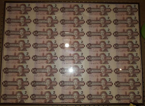 Framed uncut sheet of Canadian 2 dollar bills