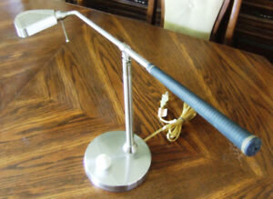 Unique golf club and ball switch table/desk lamp.