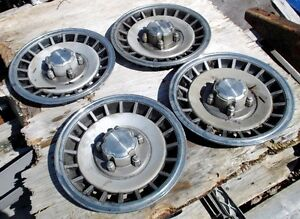 "FORD  15"" older hubcaps for sale"