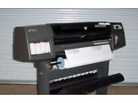 HP Designjet 1050C Plus wide format plotter including warranty, new ink and paper.