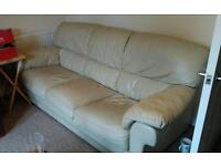 Cream leather sofa with a little wear