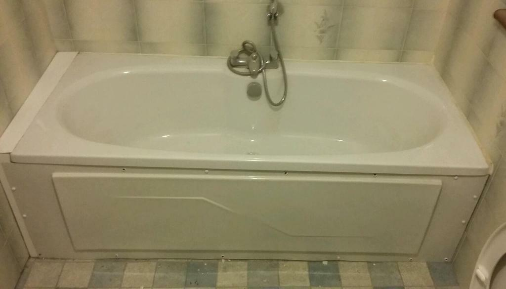 Bath with taps, shower head and waste.