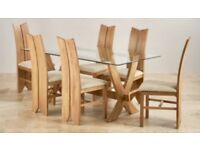 6 Chair Solid Oak Dining table set with glass top. Only 6 months old!!