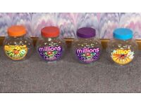 4 vintage collectable, large plastic Millions sweet jars