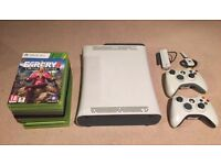 Xbox 360 console with two controllers, ten games and accessories