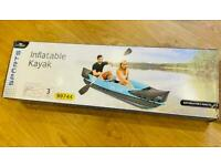 Crane inflatable 2 person kayak with Two double paddles. Brand new and unopened box.