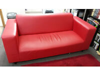 red leather effect sofa