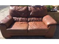 Brown leather sofa in good condition