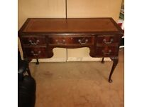 beautiful leather-top writing desk can deliver