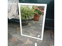 large beveled edge wall mirror in wooden frame