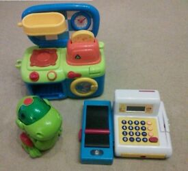 Kids Electronic Toys - mini kitchen, till & dancing dinosaur, all battery operated.
