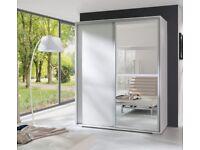 Sliding door wardrobe with mirrors in white matt finish.