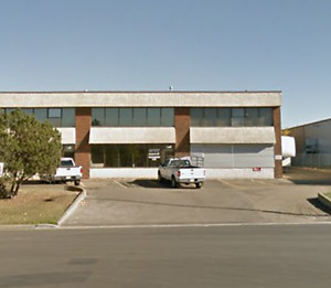 * Deal pending * Commercial warehouse with crane for lease.
