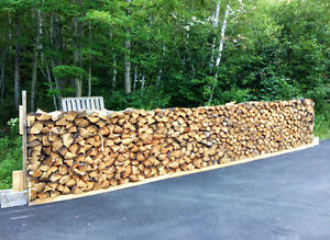 One cord of soft wood (spruce and fir) cut & split ready to burn