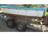 Boat with inboard diesel engine on sturdy trailer
