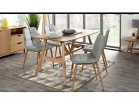 Oak Dining table and 4 grey leather chairs...BRAND NEW