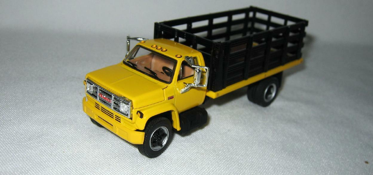 1/64th DCP 60-0966 GMC 6500 427 Engine Yellow With Single-Axle Black Stake Box