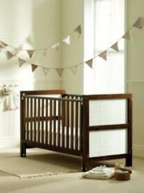 Cot bed by saplings of Shropshire walnut panelled head and tail