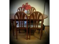 *Mahogany dining table and two chairs*