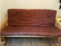 Wooden based futon, converts from a comfortable 2 seater sofa into a double bed.