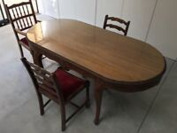 Antique Hardwood Dining Table with Carved Detailing & Protective Glass Top