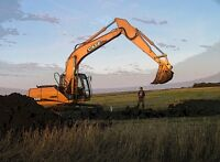 Excavator for farm demo/yard clean up and all trenching needs