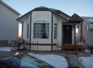 2 bedroom home for rent SW close to Fish creek station