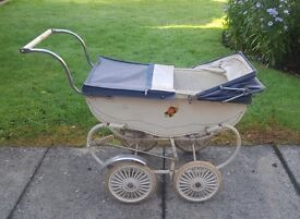 VINTAGE DOLLS PRAM dates from the 1950s or 60s