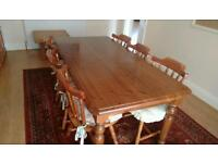 Solid wood chunky dining table and 6 chairs in very good condition