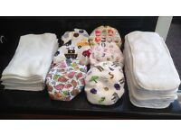 Reusable nappies with 11 microfibre inserts and 20 fleece liners