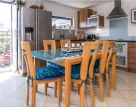 French blue glass and light wood extending dining set