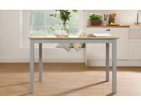 Brand new grey oak dining table... Can deliver