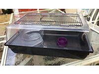 LARGE SMALL ANIMAL CAGE . USED . GOOD CONDITION . WITH WATER FEEDER AND FOOD BOWL