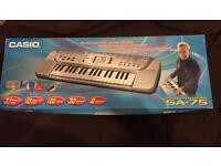 Casio Song Bank Keyboard (SA-75) with 100 tones, 30 patterns, 10 song bank, 37 keys, 3 octaves.