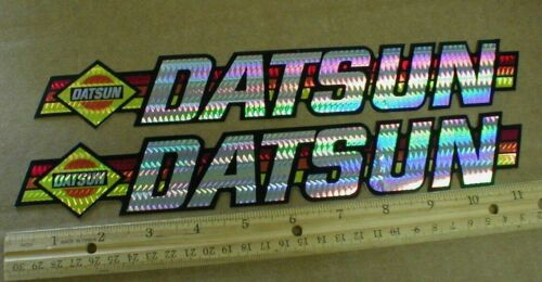 2 Vtg old Datsun rainbow license tag Prism racing decal Stickers Nissan 280z NOS