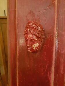 Salvaged wooden door panel with antique maiden head