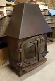 Used Wood Burning Stove with Cast Iron and Glass Panel Double Doors