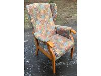 Floral fabric wing backed armchair, £40.