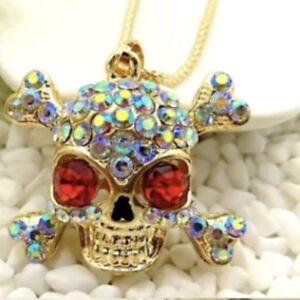 BNWT Betsey Johnson gold and ruby skull pendant with 28' chain