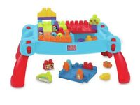 Blue mega bloks table and blocks