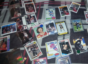 Few hundred cards hky baseball football signed cards to 70$ OBO
