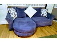 Large purple sofa with chaise and matching chair