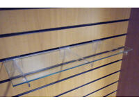 Glass slatwall shelf with brackets