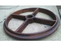 cast iron wheel for decorative display mix with flora and fauna. wall hgings