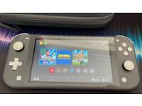 Switch Lite Grey with 3 games inc Super Mario Bros