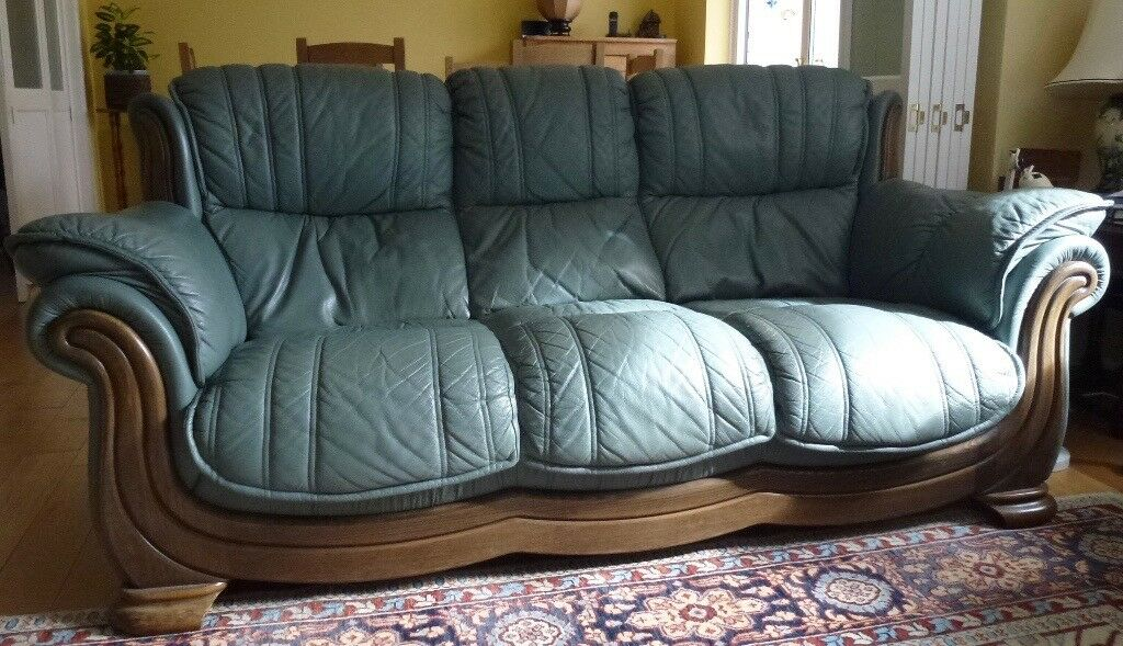 Sage green three seater leather sofa with dark wood trim, excellent  condition and very comfortable | in Cheltenham, Gloucestershire | Gumtree