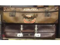 2 old suitcases